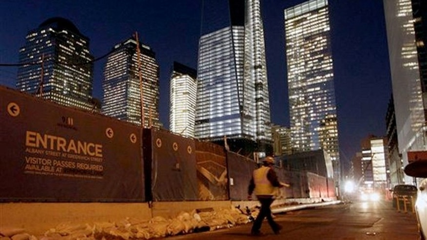 Sandbags remain around the perimeter of the World Trade Center Memorial and construction site after the memorial was closed by flooding in the wake of Superstorm Sandy.