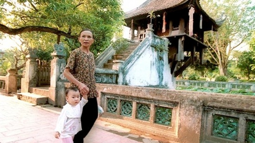 May 24, 2000: The One Pillar Pagoda is among the city's most famous sites, but many Vietnamese flock to the Tay Ho Pagoda overlooking the city's large West Lake to leave offerings and pray, especially on auspicious days.