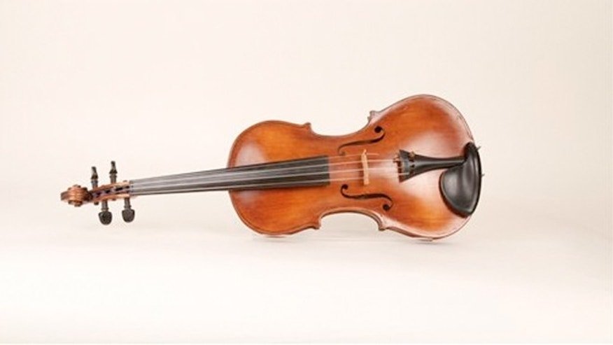 The camp-crafted violin made by Clair Cline, will be featured in the exhibit Guests of the Third Reich, which will be at the National WWII Museum Nov. 11 2012 through July 7, 2013.