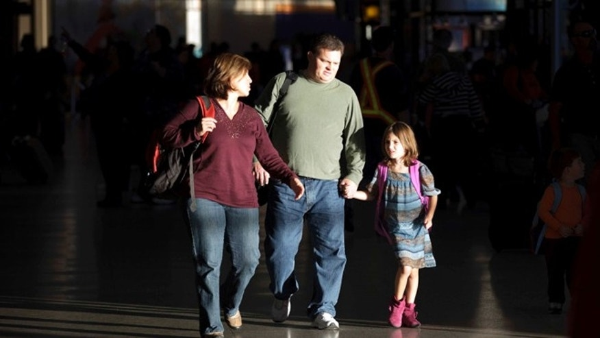 Nov. 22, 2011: A family arrives at the airport for a Thanksgiving holiday in San Diego.