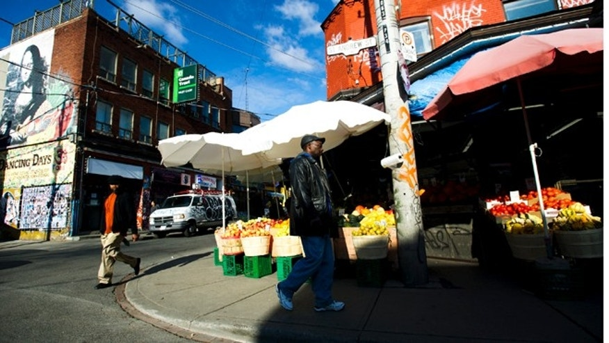 Nov. 14, 2012: People walk around at Kensington Market in Toronto.