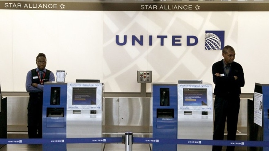 Nov. 15, 2012: United Airlines ticketing agents wait for passengers at Chicago's O'Hare International Airport.