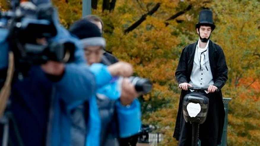 Nov. 15, 2012:  Christopher Brady, dressed as Abraham Lincoln, arrives on a Segway at the launching ceremony of the Lincoln Movie Trail at the State Capitol in Richmond, Va.