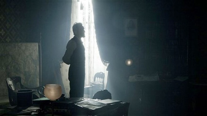 "Daniel Day-Lewis, stars as President Abraham Lincoln, in this scene from director Steven Spielberg's drama ""Lincoln."""