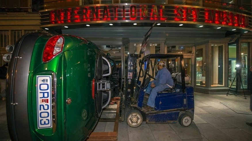 "Nov. 8, 2012: Workers move the Jaguar XKR used in the James Bond Movie ""Die Another Day"" through the front doors of the International Spy Museum in Washington."