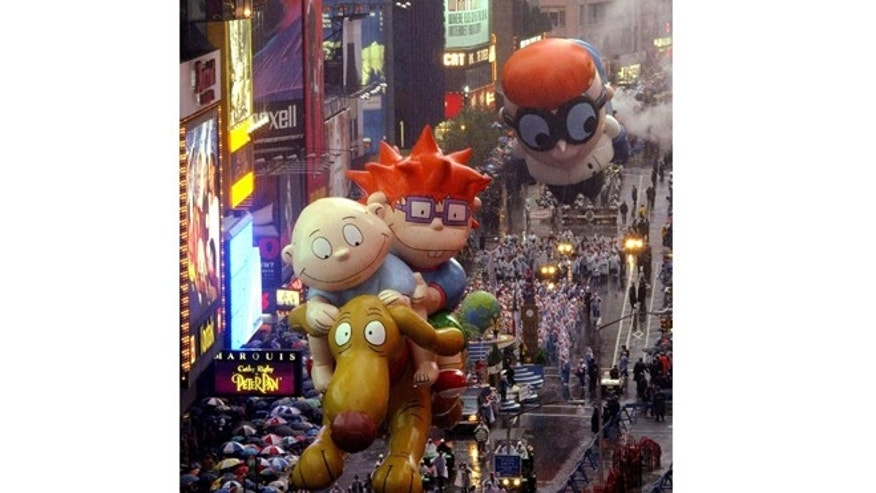 Rugrats float makes its way through Times Square during the 72nd annual Macys Thanksgiving Day Parade.
