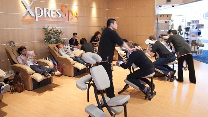 This undated image provided by XpresSpa shows the customers receiving massages and other treatments at the companys spa at John F. Kennedy International Airport in New York.