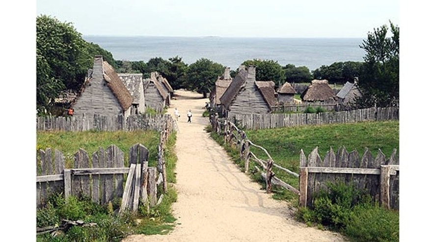 Plimoth Plantation's re-created 1627 village overlooking the harbor of Plymouth, Mass.