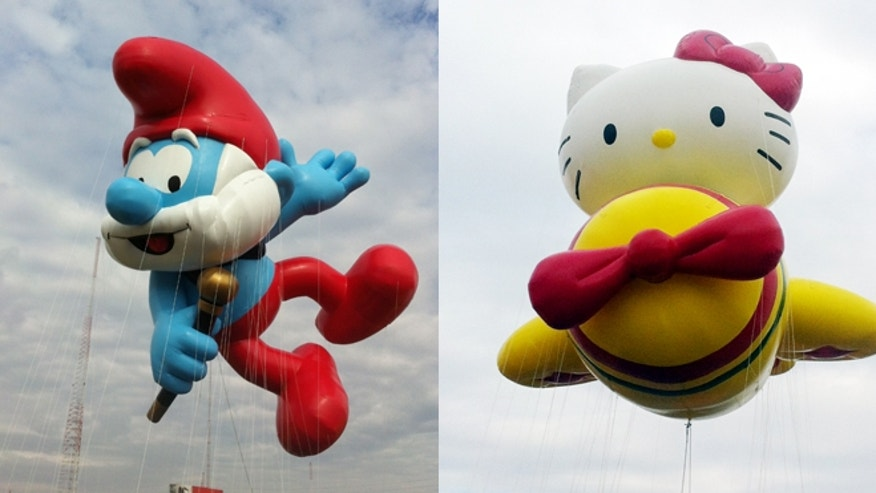 Nov. 10, 2012: The Papa Smurf (left) and Hello Kitty balloons float over the Meadowland's race track during a test flight in East Rutherford, N.J.
