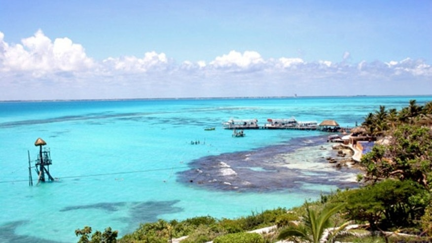 "Isla Mujeres, which means ""Island of the Women,"" is less than a 30-minute boat ride away from Spring Break oasis Cancun, but feels a world away."
