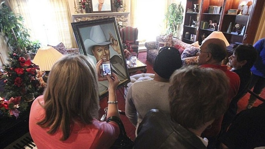 A large portrait of Larry Hagman greets fans as they take a tour of Southfork Ranch, setting for the TV show 'Dallas'.