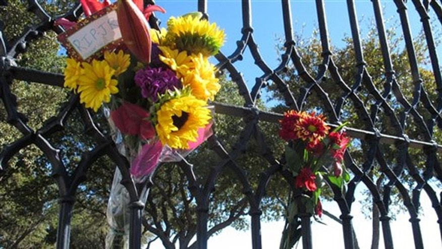 Nov. 24, 2012: Southfork Ranch can be seen through a gate where fans left flowers Saturday.