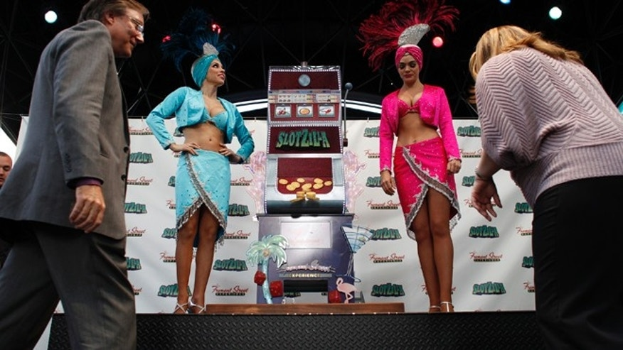 Nov. 27, 2012: Showgirls and others stand beside Slotzilla during a press conference in Las Vegas.