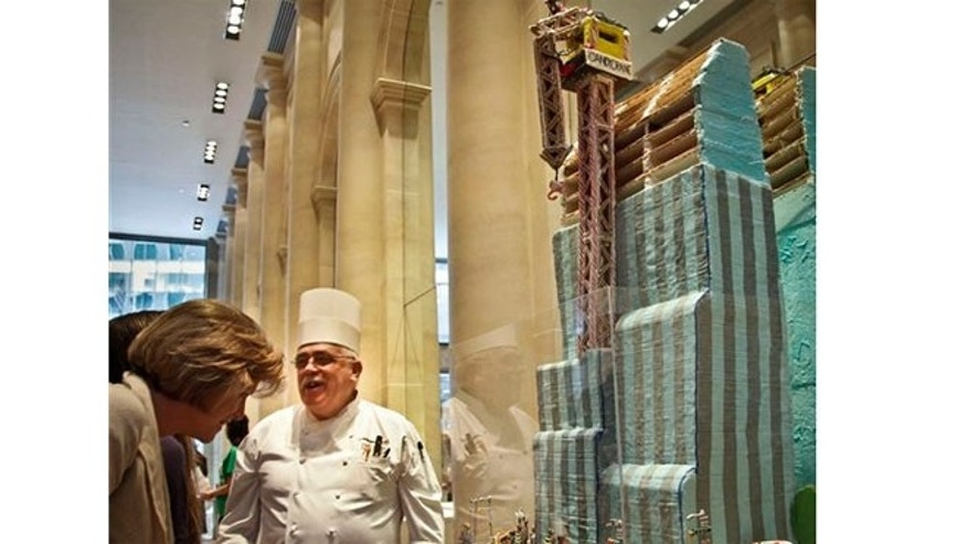 "Nov. 30, 2012:  Emile Castillo, center, an executive chef at Le Parker Meridien hotel, standing by his gingerbread creation ""The Hurri-CANE"" at his hotel in New York."