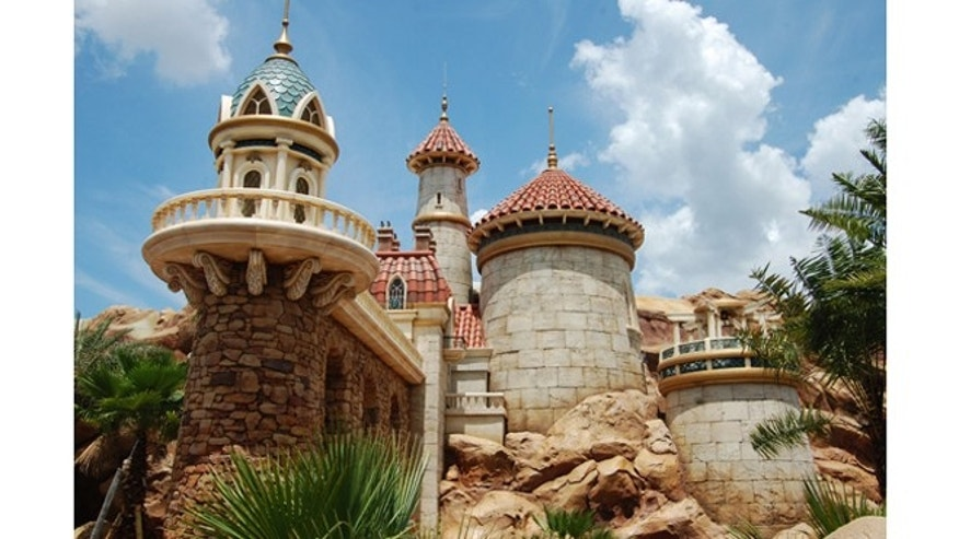 Prince Eric's Mediterranean-style castle has Spanish title roofing and oceanic-themed details, like the seaweed on the balcony support beams.