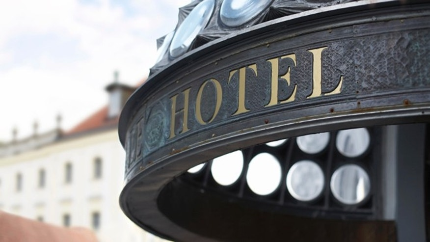 Close up of hotel header incription. Golden letters. Shallow DOF.
