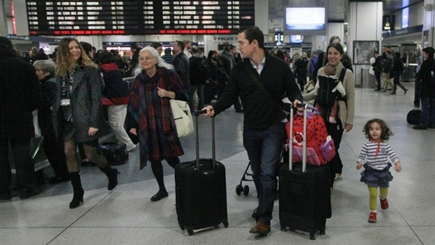 Nov. 21, 2012: Travelers walk through New York's Penn Station.