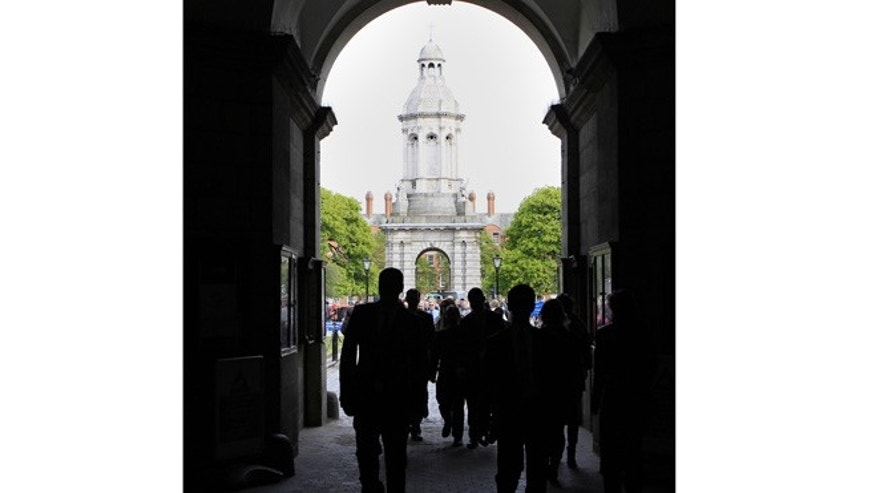 April 9, 2011: Tourists visiting Trinity College in central Dublin, Ireland.