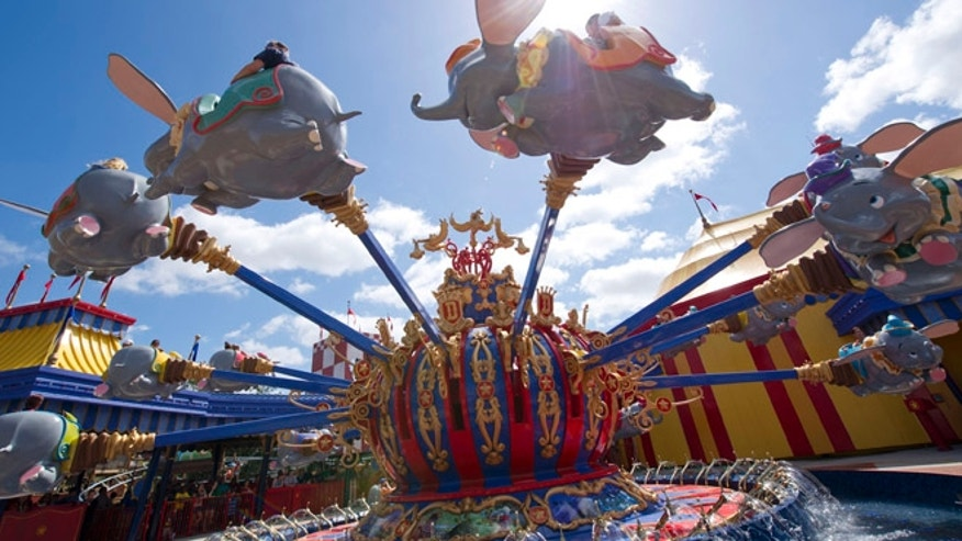 Guests take a spin on Dumbo, the Flying Elephant at Magic Kingdom Park.