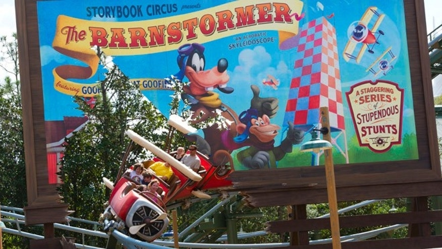 Guests take flight with Goofy on The Barnstormer.