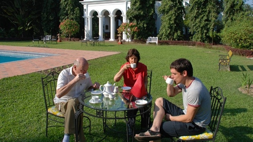 Nov. 29, 2012: People enjoy afternoon tea, a heritage from British colonial days, on the lawn of Thengal Manor in Jorhat, India.