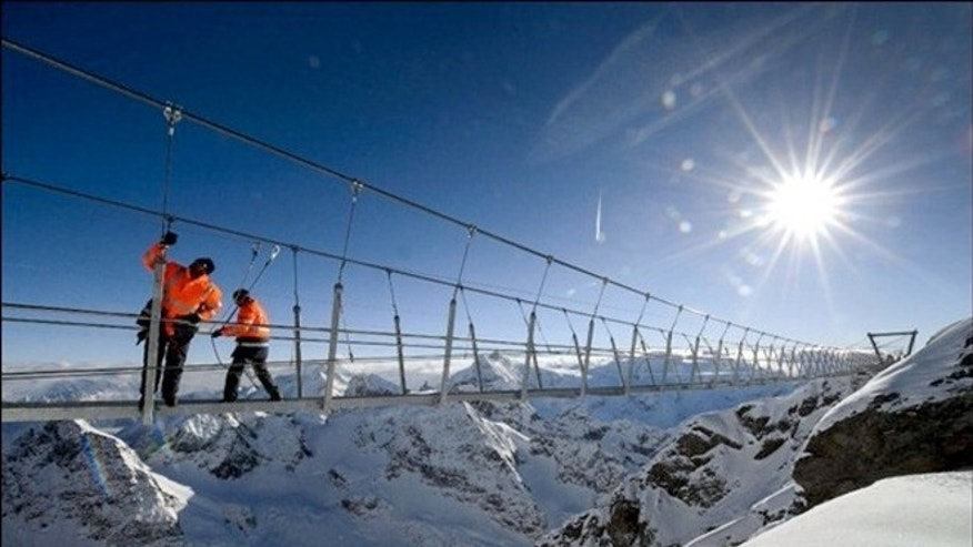 The pedestrian walkway is suspended 1,500 f.t above a glacier in the Swiss Alps.