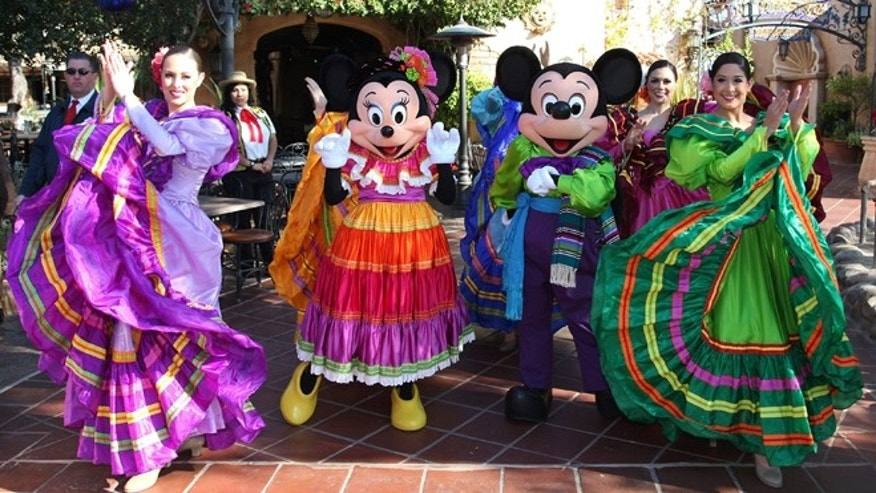 This January 2012 publicity photo provided by Disneyland shows costumed actors at the theme park's Three Kings Day celebration in Anaheim, Calif.