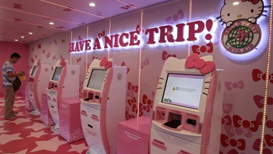 April 30, 2012: A passenger stands next to Eva Airlines' self check-in counters, which are decorated with Hello Kitty motifs, in Taoyuan International Airport, northern Taiwan.