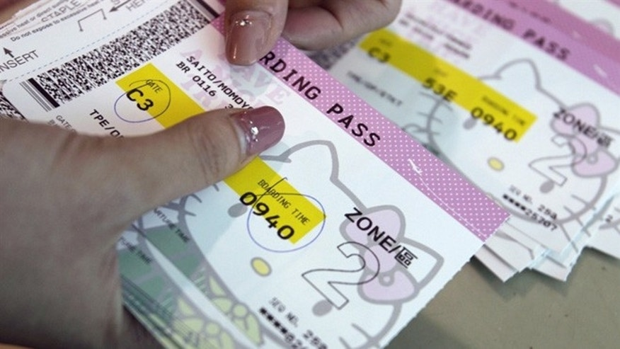 April 30, 2012: An Eva Airlines ground crew counts Hello Kitty-themed boarding passes in Taoyuan International Airport, northern Taiwan.
