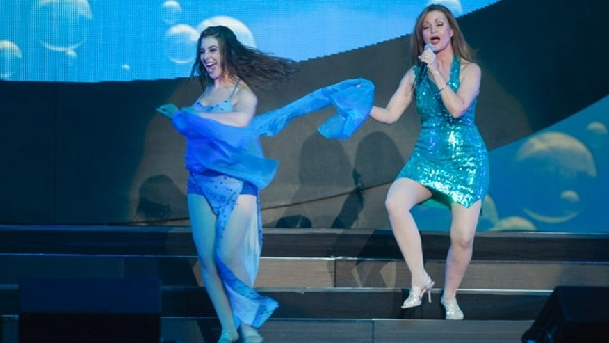 "Dec. 15, 2012: Michelle Rohl, right, an MGM employees services specialist, performs with Jenny Annon during a dress rehearsal for MGM's ""Inspiring Our World"" show at the Mandalay Bay Events Center."