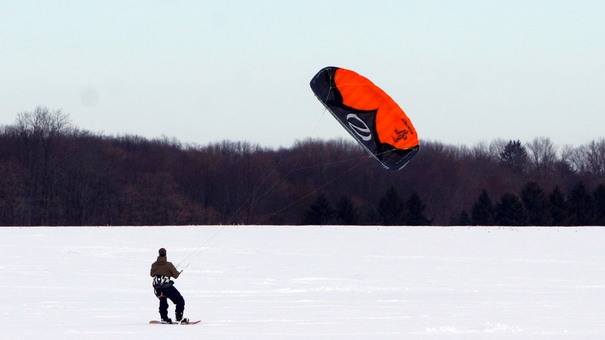 Feb. 20, 2010: John O'Malley, from Westchester County, N.Y, snowkiting across an open field in Cranbury, N.J.