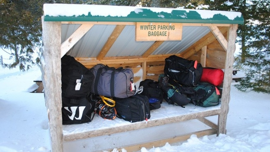 This December 2012 photo shows a small shed where luggage is left for pickup by guests at the Appalachian Mountain Club's Gorman Chairback Lodge.