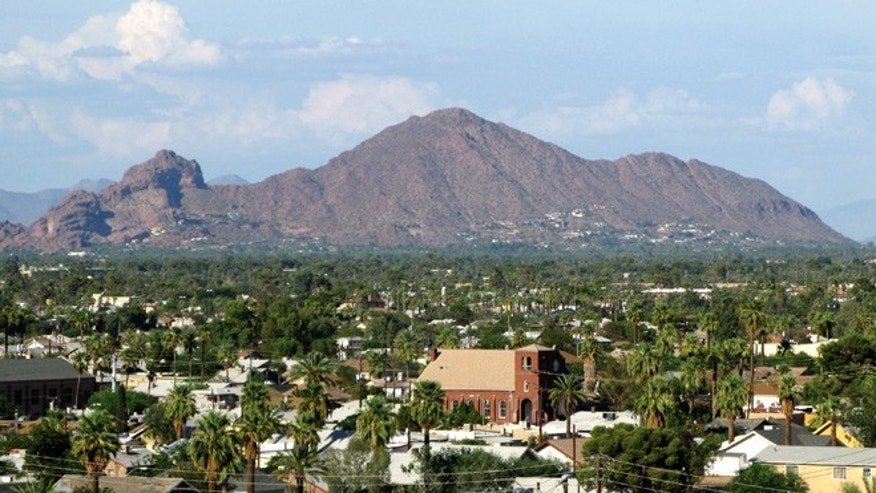 This undated image provided by the Greater Phoenix Convention & Visitors Bureau shows Camelback Mountain located between Phoenix and Scottsdale, Ariz.