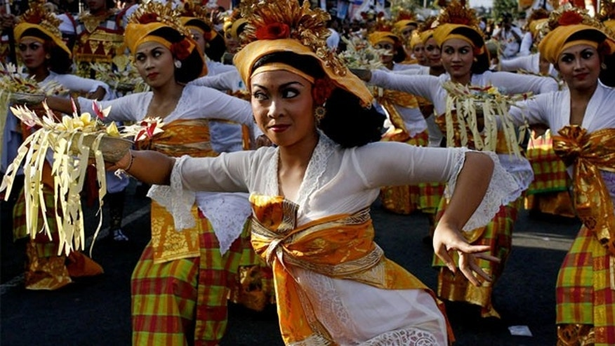 Balinese dancers outside a temple in Ubud.  The belief among some religions, including Hinduism, is that menstruating women are impure and shouldn't enter temples during when they have their periods.