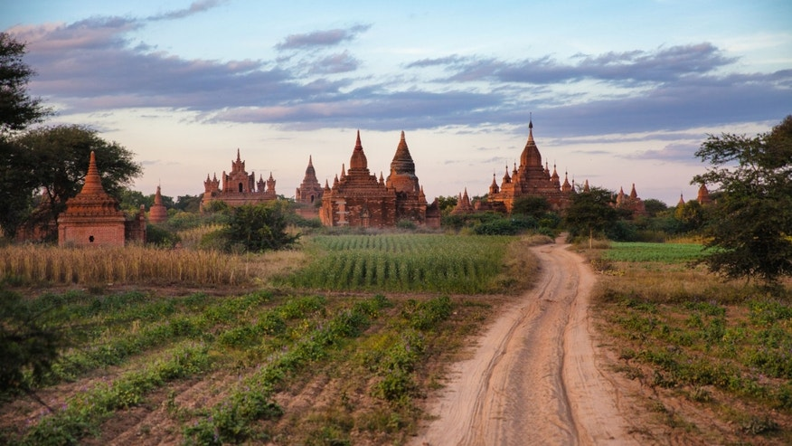 This December 2012 photo shows agricultire and some of the over 2200 Pagodas found in Bagan, Myanmar. (AP Photo/Richard Camp)