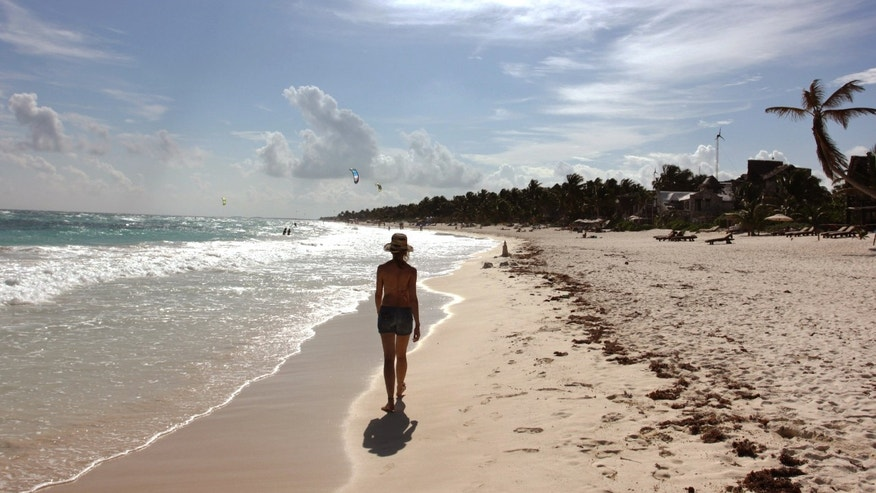 Jan. 4, 2013: A woman walks along the beach in Tulum.