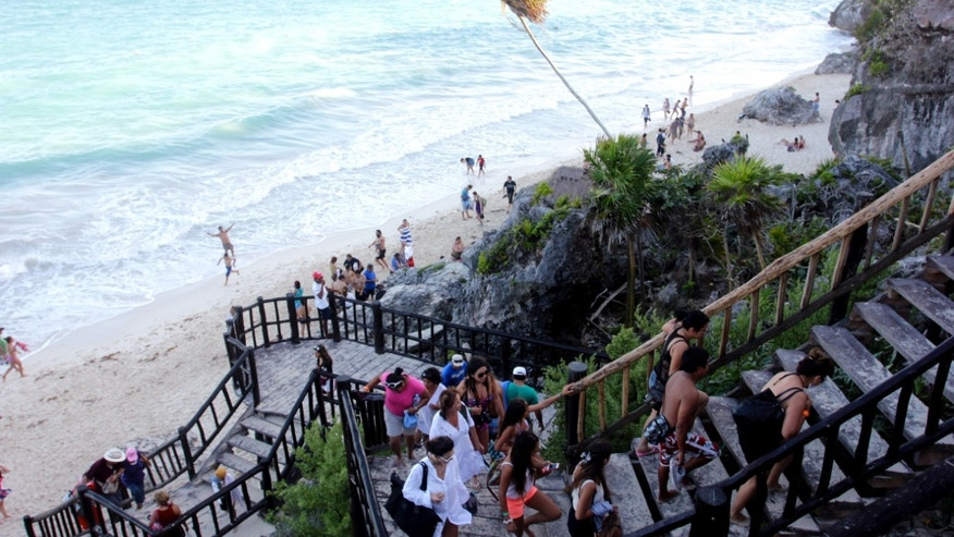 Jan. 4, 2013: A line of people leave the swimming beach next to the Mayan ruins in Tulum, Mexico.