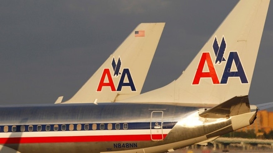 Oct. 11, 2012: The tail sections of two American Airlines passenger jets as they taxi at Miami International Airport.