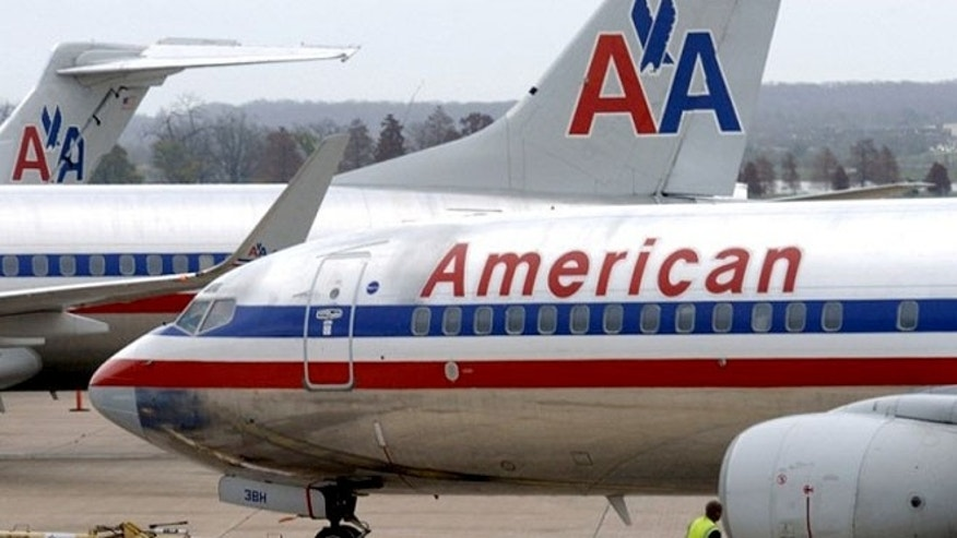 Gone are the red, white and blue stripes along the side of the fuselage with an eagle soaring between double 'A'.