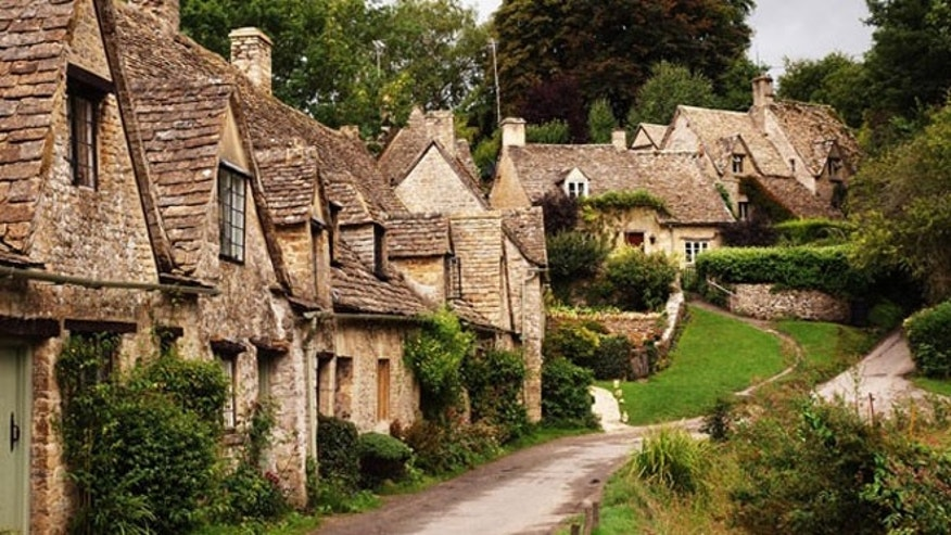 "Located on the River Coln in hilly west-central England, Bibury was described by 19th-century artist-writer William Morris as ""the most beautiful village in England."""
