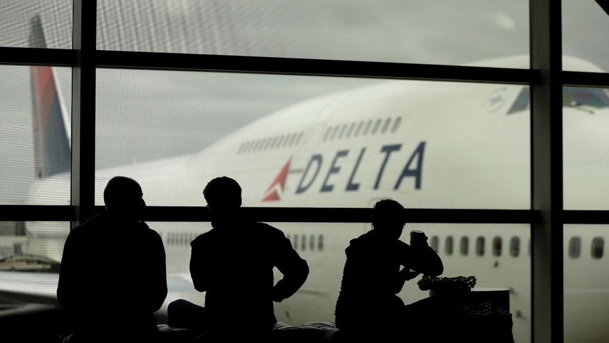 Oct. 29, 2012: Travelers on Delta Airlines waits for flights in Detroit.