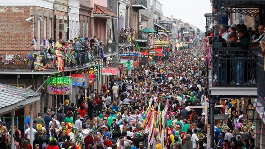 March 8, 2011: Crowds throng Bourbon Street in the French Quarter on Mardi Gras day in New Orleans.