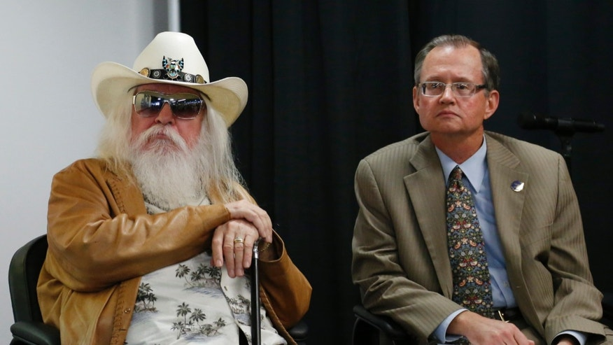 Jan. 29, 2013: Leon Russell, left, leans on his cane as he sits with Bob Blackburn, executive director of the Oklahoma Historical Society, in Tulsa, Okla.
