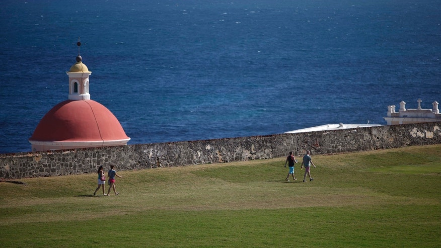 Jan. 24, 2013: Tourists walk near the 16th century Spanish fort called El Morro in Old San Juan, Puerto Rico.