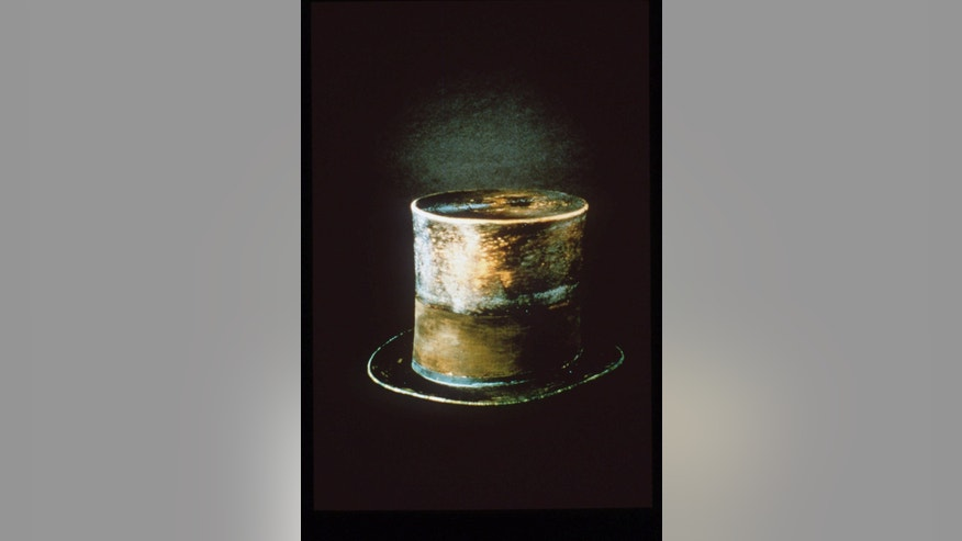 FILE - This undated file photo originally released by the Smithsonian, the top hat President Abraham Lincoln wore the night he was assassinated, is shown.