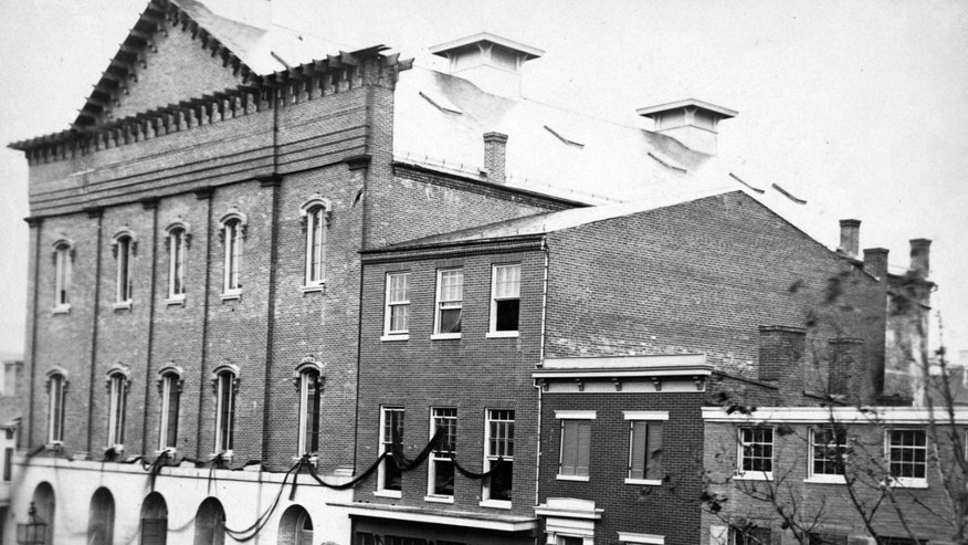 FILE - In this undated photo provided by the Library of Congress shows Ford's Theatre, at left, the scene of the assassination of President Abraham Lincoln, in Washington, D.C., in 1865.
