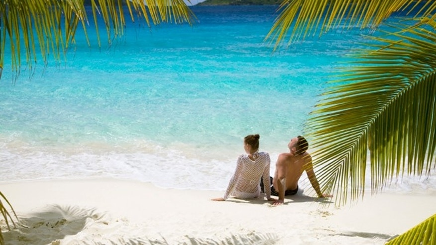 couple relaxing on the beach in the caribbean