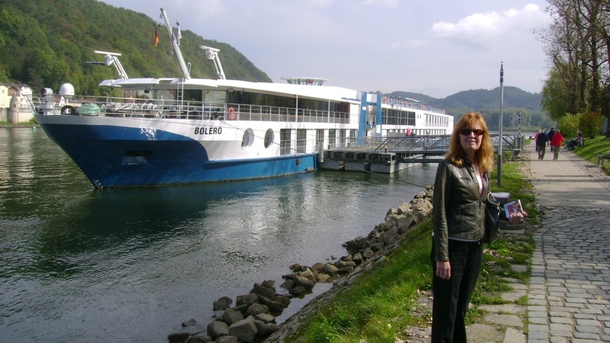 This 2012 photo shows Betty Adams in Passau, Germany, with the MS Bolero, a Viking River Cruises ship.