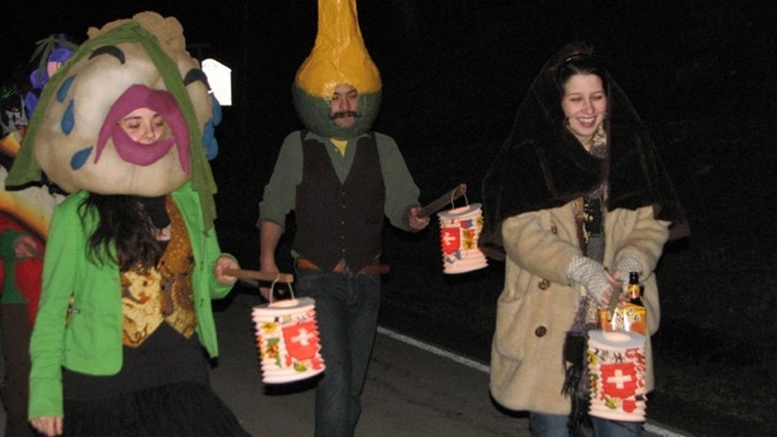 Feb. 18, 2012: Parade participants wearing costumes and holding Lampions, which are paper candle lantern that are carried on sticks, at the 2012 Fasnacht in Helvetia W.Va.