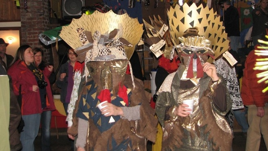 Feb. 18, 2012: Revelers wearing masks and costumes marching in a parade during the 2012 Fasnacht in Helvetia W.Va.